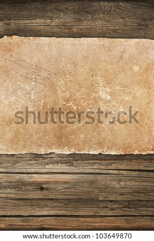 Faded old paper on wood - stock photo