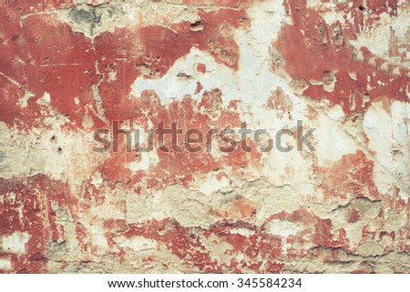 Faded red cracked peeled wall surface texture background. Vintage effect. - stock photo