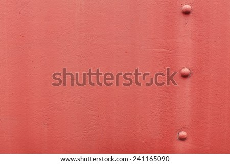 Faded red pink steel metal with rivet screws and faded water erosion - stock photo