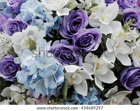 Faded tone of purple and blue flower background