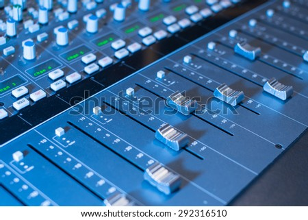 faders of Professional audio mixing console  - stock photo