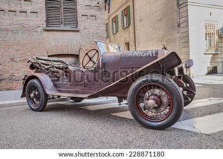 "FAENZA, ITALY - NOVEMBER 2: Fiat 501 S4 (1921) used in the Movie 1900 (Novecento) by B. Bertolucci, at classic car rally, during the festival ""Fiera di San Rocco"" on November 2, 2014 in Faenza, Italy  - stock photo"