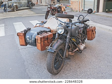 """FAENZA, ITALY - NOVEMBER 2: old BMW R75 750 cc, World War II-era German sidecar motorcycle, at the military vehicle rally during the festival """"Fiera di San Rocco"""" on November 2, 2014 in Faenza, Italy  - stock photo"""