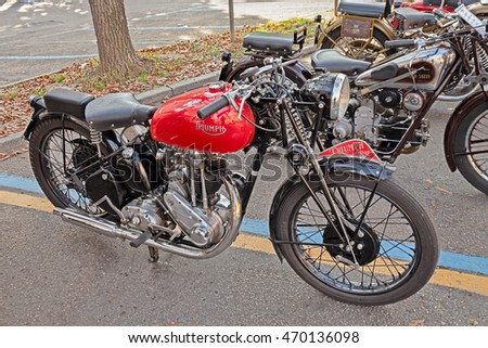 "FAENZA, ITALY - NOVEMBER 1: old british motorbike Triumph 3H 350 cc (1942)in classic motorcycle rally during the festival ""Fiera di San Rocco"" on November 1, 2015 in Faenza, Italy"