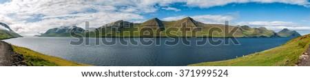 Faer Oer Danmark Mykines Village Island Cliffs Panorama - stock photo