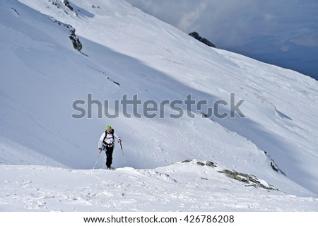 FAGARAS, ROMANIA - MARCH 5: Ski mountaineer competes during the Ski Mountaineering National Competition in Fagaras Mountains, Carpathian Range, on March 5, 2016 in Romania.
