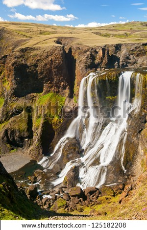 "Fagrifoss (""Beautiful waterfall"") is one of the most spectacular falls on Icealnd. It is located on the South not far from the volcano Laki - stock photo"