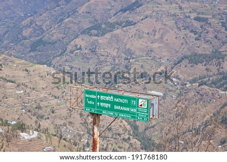 FAGU, INDIA - MARCH 20, 2014: Road sign on national highway 22 at Fagu in Himachal Pradesh, India in the Himalayan foothills. The road leads to India's border with territorially disputed Tibet
