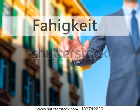 Fahigkeit (Ability in German) - Businessman hand pressing button on touch screen interface. Business, technology, internet concept. Stock Photo - stock photo