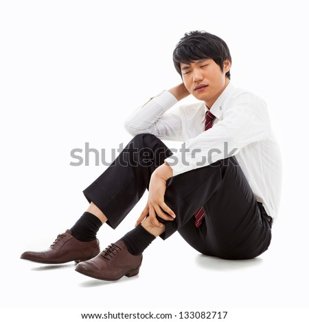 Fail Asian business man isolated on white background.