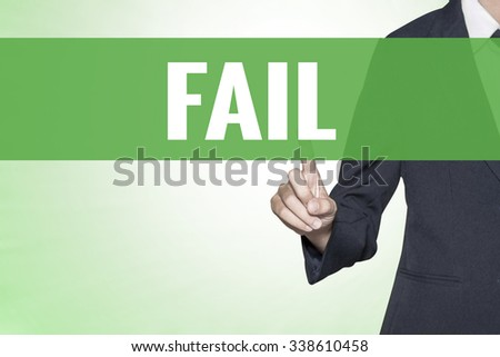 Fail word on green virtual screen touching by business woman - stock photo