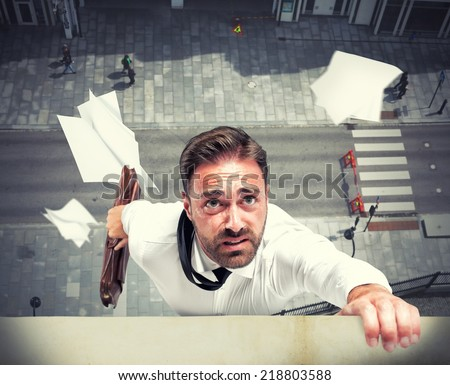 Failure of a businessman due to economic crisis - stock photo