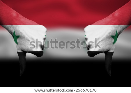 failure of Syria - hands gesturing thumbs down in front of flag - stock photo