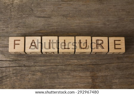 failure on wooden cubes - stock photo