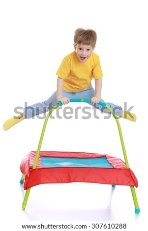 Fair-haired little boy with brown eyes jumping on a trampoline-Isolated on white background - stock photo