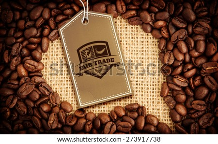 Fair Trade graphic against coffee beans with speech bubble indent for copy space