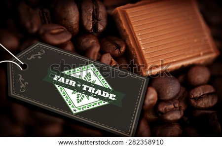 Fair Trade graphic against piece of chocolate and coffee seeds together - stock photo