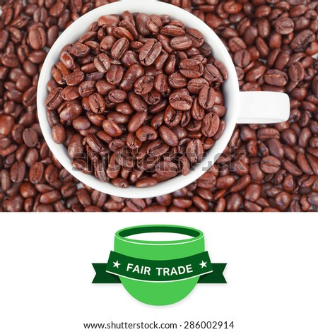 Fair Trade graphic against small white cup full of coffee beans - stock photo