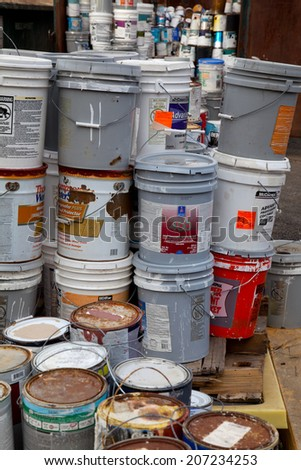 FAIRFAX, VA - DECEMBER 5: Paint cans stacked in a container to be brought to a recycling facility on December 5, 2013 in Fairfax, VA. The metal will be sorted, melted and recycled.