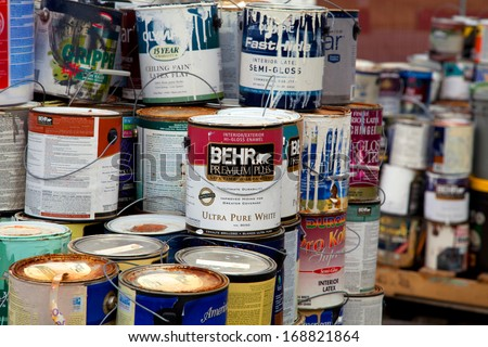FAIRFAX, VA - DECEMBER 5: Paint cans stacked in a recycling facility on December 5, 2013 in Fairfax, VA. The metal will be sorted, melted and recycled. - stock photo