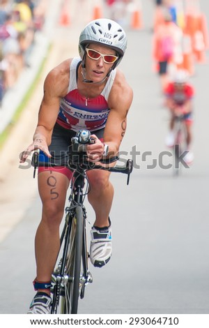 FAIRFAX, VA - JULY 3: A cyclist competes in the triathlon at the World Police & Fire Games on July 3, 2015
