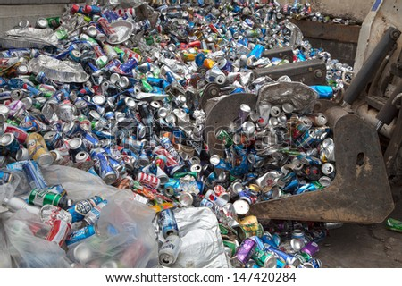 FAIRFAX, VA - JULY 24: Aluminum cans lying in a heap at an undisclosed recycling facility on July 24, 2013 in Fairfax, VA. The cans will be sent to an aluminum foundry. - stock photo