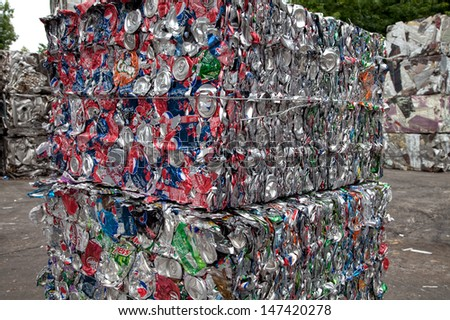 FAIRFAX, VA - JULY 24: Bales of crushed aluminum cans waiting at an undisclosed recycling facility on July 24, 2013 in Fairfax, VA. The cans will be sent to an aluminum foundry. - stock photo