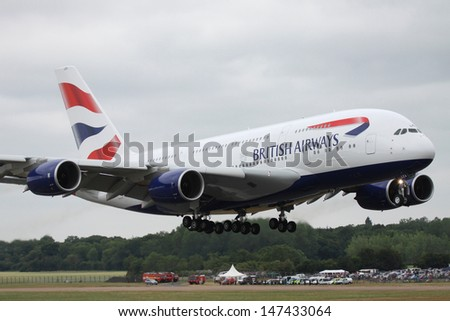 FAIRFORD.ENGLAND-JULY 20: The first public appearance of an Airbus A380 in British Airways colours at the Royal International Air Tattoo on JULY 20,2013. - stock photo