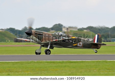 FAIRFORD, UK - JULY 8: Royal Air Force Spitfire aircraft participates in the Royal International Air Tattoo airshow event July 8, 2012 near Cirencester, England. - stock photo