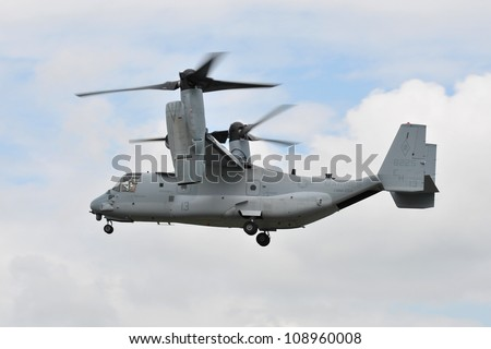 FAIRFORD, UK - JULY 8: US marines Osprey Tilt rotor participates in the Royal International Air Tattoo airshow event July 8, 2012 near Cirencester, England. - stock photo