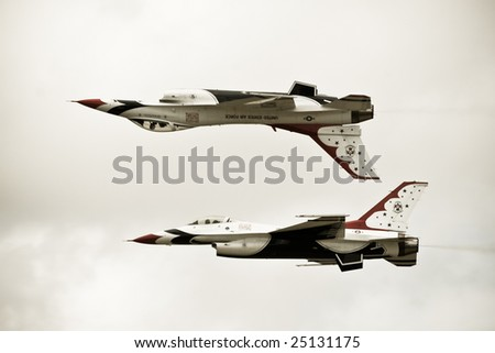 FAIRFORD, UNITED KINGDOM - JULY 14: For the first time in history, the USAF Thunderbirds aerobatics team performs at the Royal International Air Tattoo July 14 and 15, 2007 in Fairford. - stock photo