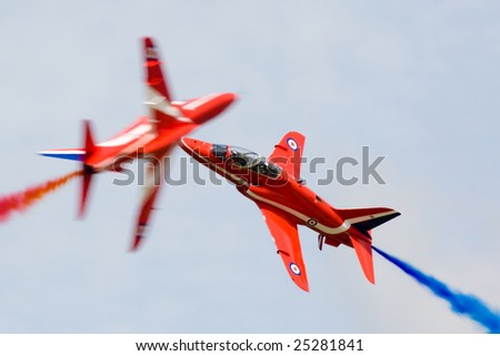 FAIRFORD, UNITED KINGDOM - JULY 14: The famous RAF aerobatics team Red Arrows performs at the Royal International Air Tattoo July 14 and 15, 2007 in Fairford. - stock photo