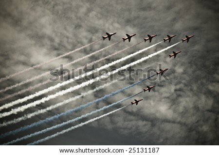FAIRFORD, UNITED KINGDOM - JULY 14: The RAF aerobatics team 'Red Arrows' performs at the Royal International Air Tattoo July 14 and 15, 2007 in Fairford. - stock photo
