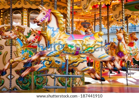 Fairground carousel horses during the day - stock photo