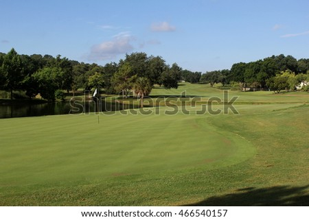 fairway and green on lush golf course