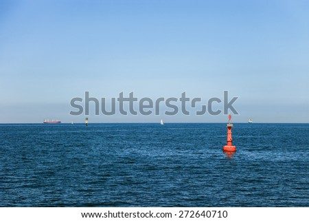 Fairway at sea with ships in the background. - stock photo