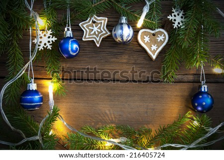 Fairy Lights and Different Christmas Decorations on Wood as Christmas or Winter Background with Copy Space - stock photo