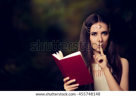 Fairy Princess Girl Reading Mysterious Secret Book - Magic portrait of fairytale goddess woman in nature  - stock photo