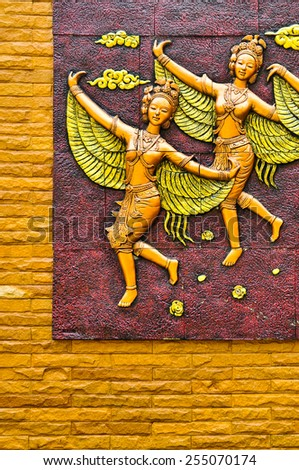 Fairy wings Thai stucco on the temple wall - stock photo