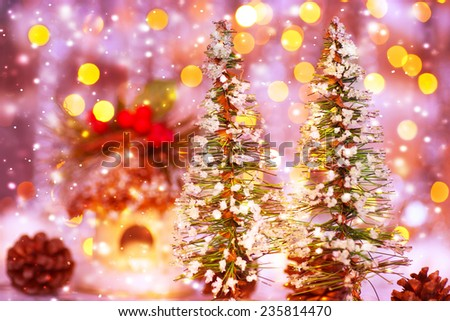 Fairytale Christmas, two little decorated Christmas trees on festive lights background, beautiful still life, cute home decoration - stock photo