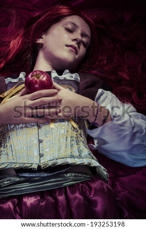 Fairytale, Teen with a red apple lying, tale scene - stock photo