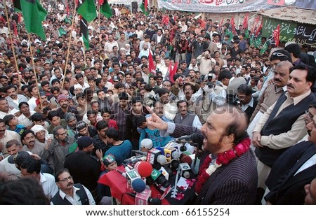 FAISALABAD, PAKISTAN - NOV 28: Federal Minister for Law, Justice and Parliamentary Affairs, Dr.Babar Awan, addresses public meeting on November 28, 2010 in Faisalabad.