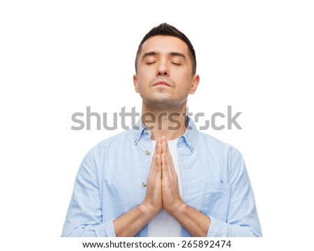 faith in god, religion and people concept - happy man with closed eyes praying - stock photo