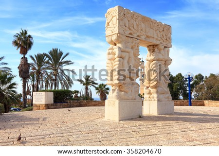 "Faith stone sculpture ( ""A belief gate"") on the highest point of Old Yafo. Church of St.Peter in the background. Tel-Aviv.Israel  - stock photo"