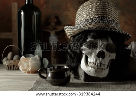 Faithful and sin concept on religion abstract with skull wearing hat and Christian cross in background - stock photo