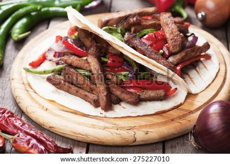 Fajitas, mexican beef with grilled vegetable in tortilla wraps