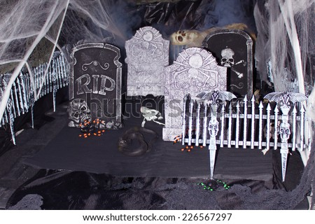 Fake cemetery with graves and crosses, a decoration for Halloween.