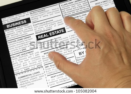 Fake Classified Ad, newspaper and Touch Screen, Real estate concept.