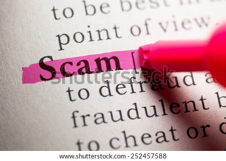 Fake Dictionary, definition of the word scam. - stock photo
