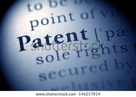 Fake Dictionary, Dictionary definition of the word Patent. - stock photo